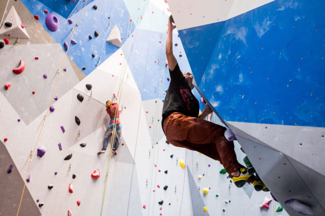 The power of high school climbing: bouldering at Eagle Climbing + Fitness.