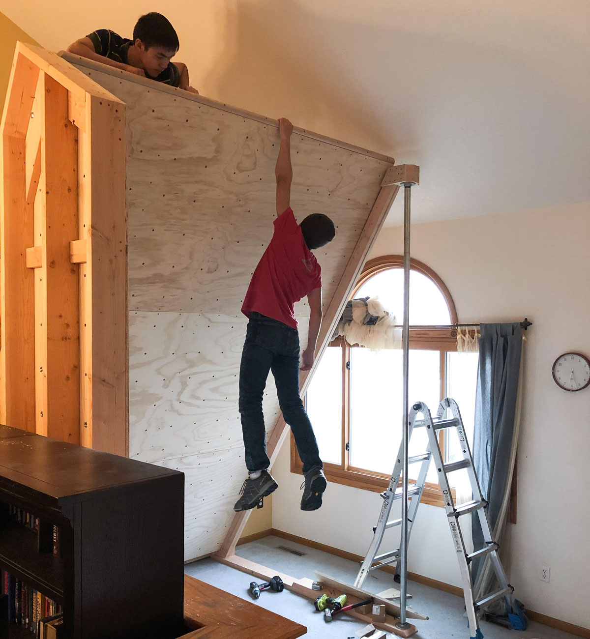 Homewall of the Week: Fort Collins - top rail on your home climbing wall is a nice touch