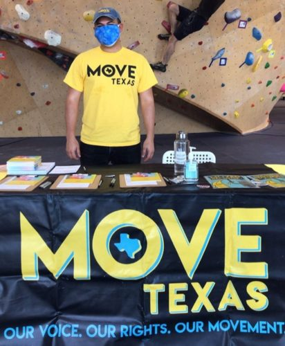 MOVE Texas voting registration booth at the climbing gym