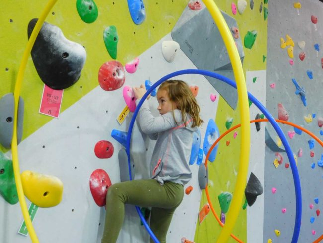Kids climbing wall at a Summer Youth Program