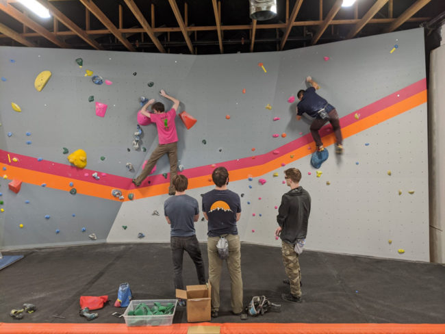 Climbing competitions in a COVID-19 world won't have climbers standing this close together.
