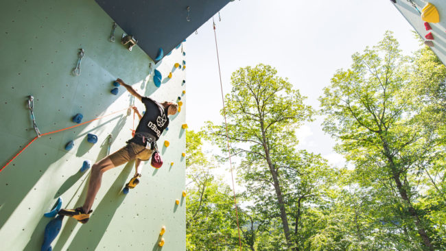 Lead climbing on an outdoor Delire structure