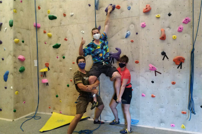 Showing solidarity in wearing masks at Strait Up Climbing