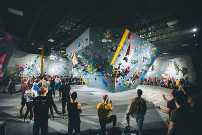 Comp bouldering on a stand-alone structure at Delire gym