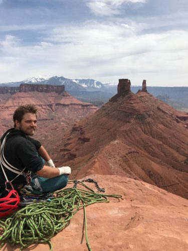 Elliot Lacroix climbing with ropes outside