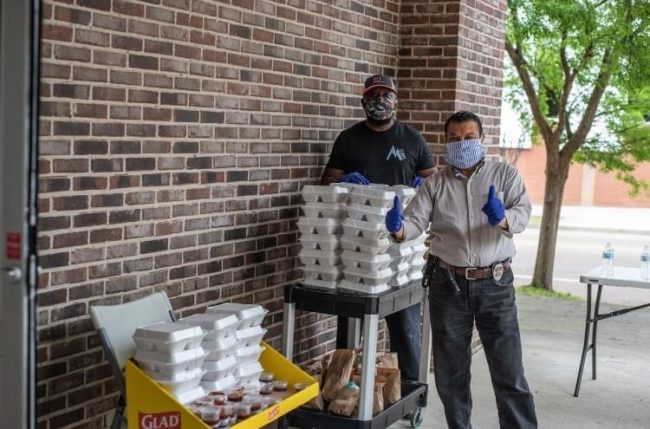 Volunteers giving out free lunches at Memphis Rox