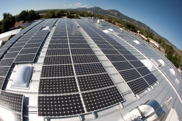 Movement Climbing roof top solar panels. Photo: Movement.
