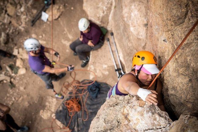 Jessica Sporte climbing outdoors.