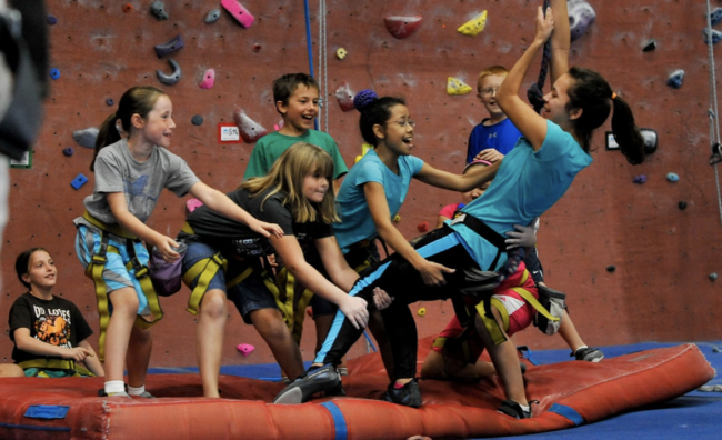Summer Youth Program Marketing - Summit Climbing youth with their instructor.
