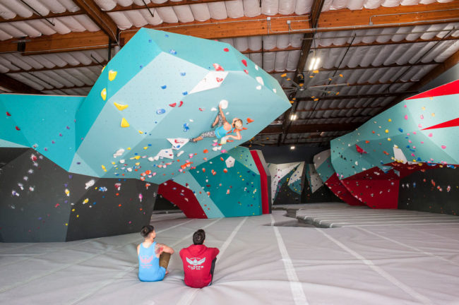 Interior design trends in climbing: teal as a signature accent at Touchstone Cliffs of Id