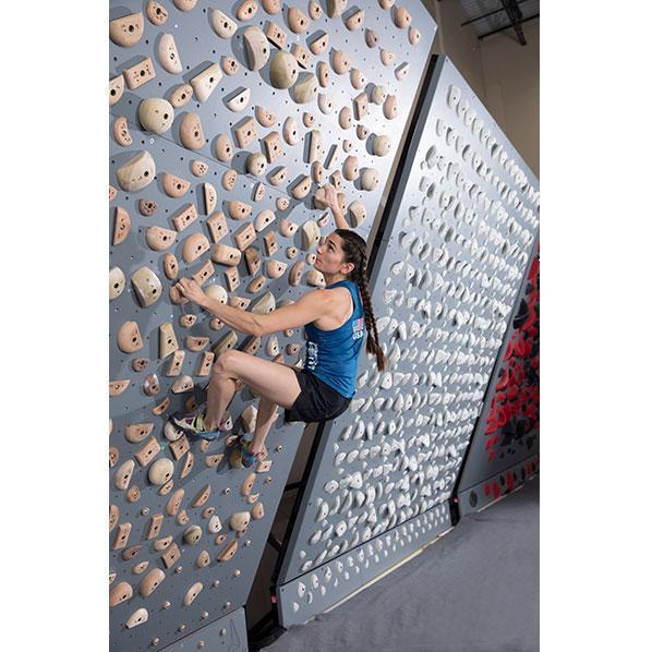 Kyra Condie training on Kumiki's EverActive wall