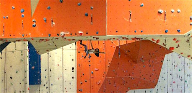 A young climber tackles the middle of the massive roof at Stone Summit.  Photo: Stone Summit
